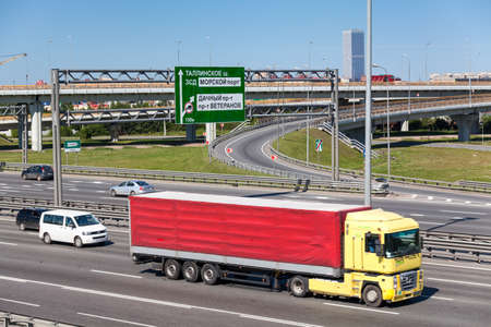 autotruck: SAINT-PETERSBURG, RUSSIA - CIRCA JULY, 2014: The Saint-Petersburg city encircling highway with a vehicles and cargo truck are on the road. The federal public ringroad