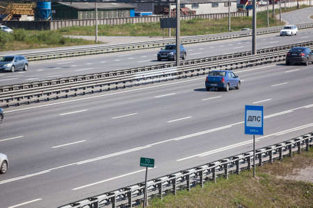 encircling: SAINTPETERSBURG RUSSIA CIRCA JULY 2014: Vehicles are on multilane city encircling highway. The federal public ringroad is around the city Editorial