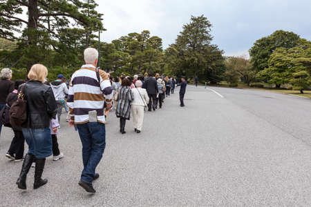 guides: TOKYO, JAPAN - CIRCA APR, 2013: Tourists with guides visit the inner area of Tokyo Imperial Palace. Tokyo Imperial Palace is the main residence of the Emperor of Japan