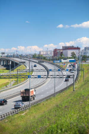 encircling: SAINTPETERSBURG RUSSIA CIRCA JULY 2014: Cars are on multilane encircling highway. The federal public ringroad is around the city Editorial