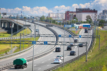 encircling: SAINTPETERSBURG RUSSIA CIRCA JULY 2014: Traffic on multilane city encircling highway. The federal public ringroad is around the city Editorial