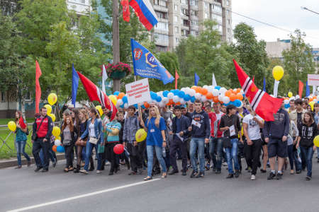 procession: KOLPINO, SAINT-PETERSBURG, RUSSIA - CIRCA SEPTEMBER, 2014: Students take part in the Parade of the city day celebration. Procession is on the Kolpino town streets Editorial