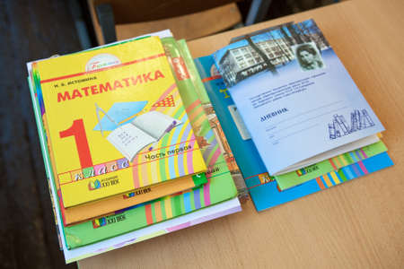 ST. PETERSBURG, RUSSIA - CIRCA SEP, 2014: School exercise and ABC books lay on the desk in classroom. Children go back to school at first time in September Éditoriale