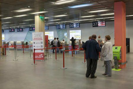 arriving: YEKATERINBURG, RUSSIA - CIRCA JUL, 2015: Departure lounge with passengers is in Koltsovo airport. Koltsovo International Airport is the international airport in Sverdlovsk Oblast Editorial