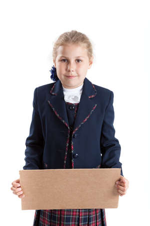 paperboard: Caucasian schoolgirl holding paperboard in hands, looking at camera, isolated on white background