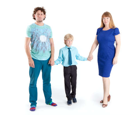 schooler: Father and mother with son a schooler looking at camera, isolated on white background Stock Photo
