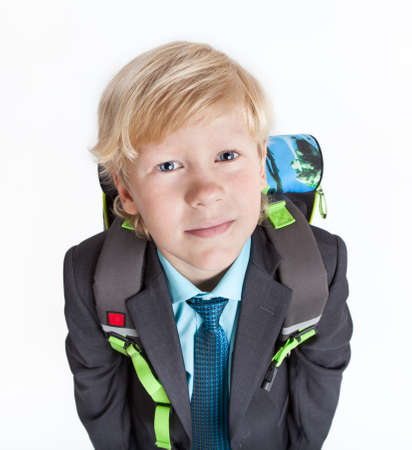 schooler: Portrait of schooler with school backpack looking at camera, isolated on white background