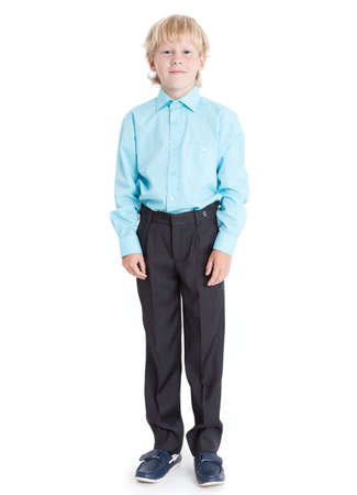 1 boy only: Standing blond boy wearing blue shirt looking at camera, full length, isolated on white background Stock Photo