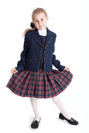 checkered skirt: Schoolgirl holding hands her checkered skirt, full-length, isolated on white background