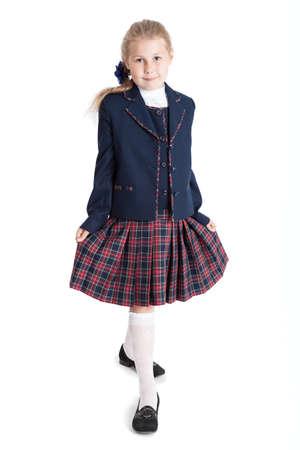 checkered skirt: Schoolgirl wearing checkered skirt making curtsey, full-length, isolated on white background