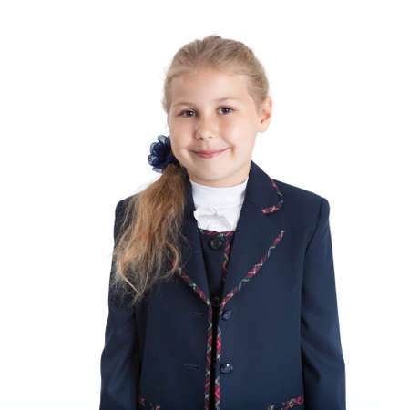 seven years: Half length portrait of seven years old student in uniform, blond hair girl, isolated on white background Stock Photo