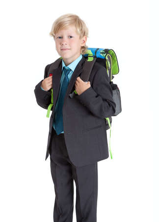 seven years: Seven years old schoolboy with schoolbag hanging on the back, isolated on white background