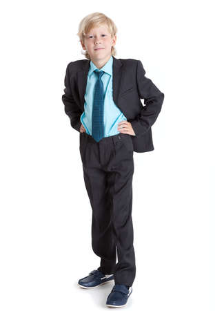 1 boy only: Young blond boy a businessman full length wearing in suit and tie, isolated on white background
