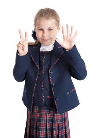 schoolgirl uniform: Schoolgirl in shool uniform showing seven fingers, isolated on white background