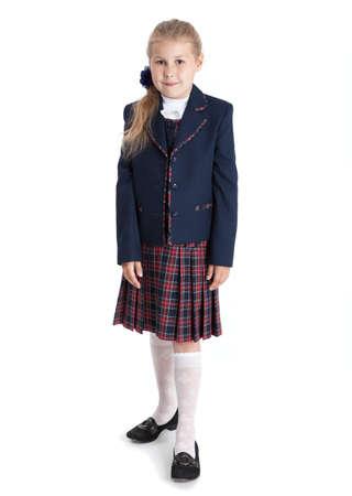 schoolgirl uniform: Full length portrait of first grade Caucasian pupil in school uniform, girl isolated on white background