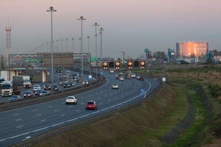 City beltway at dusk, driving vehicles, top view Stock Photo