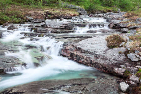 alpine tundra: Mountain stream of melt water flowing from the peaks, long exposure