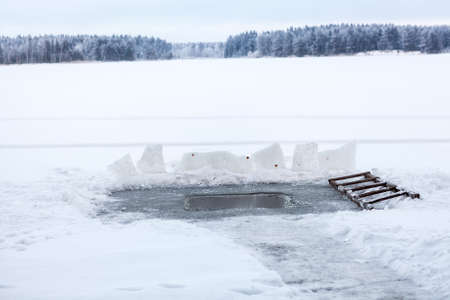 the water hole: Water hole in the ice of lake at winter day, nobody