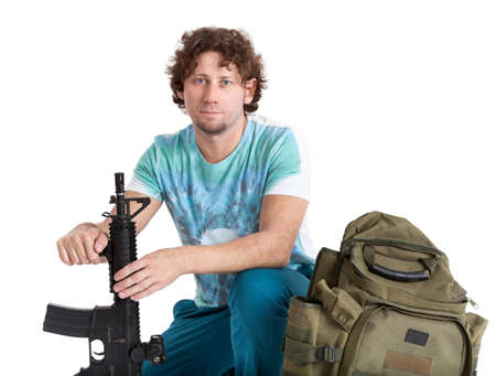 isolated man: Conscript curly hair adult man ready for his military service, person with machine gun and backpack, isolated on white background Stock Photo