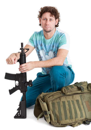 duffel: Rookie man with a machine gun and duffel bags sitting, isolated on white background Stock Photo