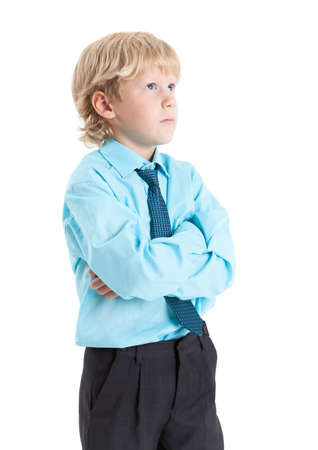 clasped hands: Young blond boy in blue shirt and tie standing with clasped hands, isolated on white background