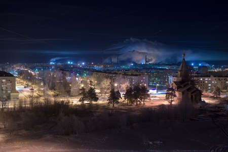 time lapse: View of a provincial industrial town in the winter night. Russia Stock Photo