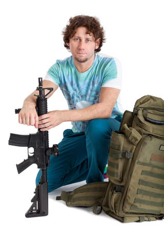 machinegun: Conscript man ready for his military service, person with machinegun and backpack Stock Photo