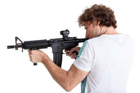 hand gun: Rear side view of curly hair adult man aiming with black machinegun, isolated on white background Stock Photo