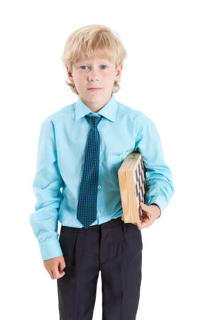 school age boy: School age boy holding chessboard in his hands, isolated on white background