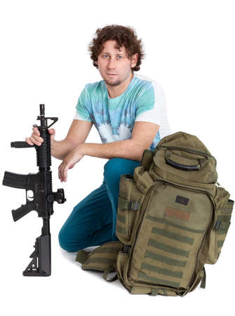youth crime: Conscript curly hair man ready for his military service, person with machine gun and backpack, isolated on white background