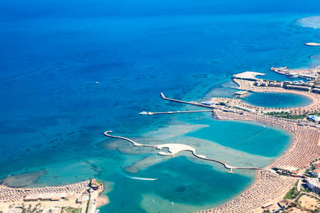 Sea bays with piers and locations enclosured for swimming, Egyptian resorts, aerial view, the Red Sea, Egypt