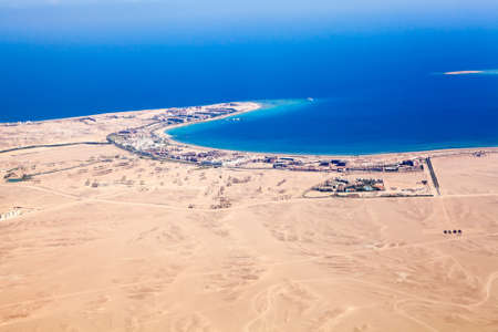 paradise bay: Aerial view at the sandy desert terrain and Red sea coast in Hurghada, Egypt