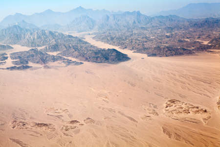 high desert: The Horeb mountains in Egypt on Sinai Peninsula with Sahara desert, aerial view