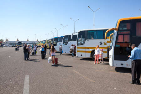 busses: HURGHADA, EGYPT - CIRCA NOV, 2015: International Airport of Hughada with passenger busses are at the parking lot. Russian tourists transfer to hotels
