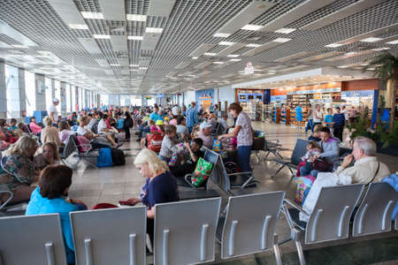 gatehouse: HURGHADA AIRPORT, EGYPT - CIRCA NOV, 2015: Passenger traffic of Russian tourists is in Hurgada International Airport. People are waiting departure and from Egypt to Russia Editorial