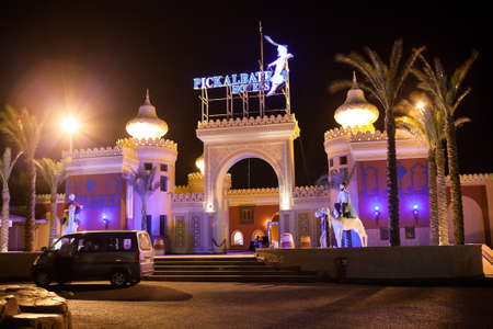 alf: HURGHADA, EGYPT - CIRCA NOV, 2015: View at the night illumination of main entrance of the Egyptian hotel. The Alf Leila Wa Leila spa 1001 Nights is one of the Pickalbatros