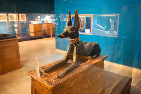 alf: HURGHADA, EGYPT - CIRCA NOV, 2015: Wooden statue of the dog goddess is in the hotel museum. The Alf Leila Wa Leila spa 1001 Nights is one of the Pickalbatros chain in Hurgada