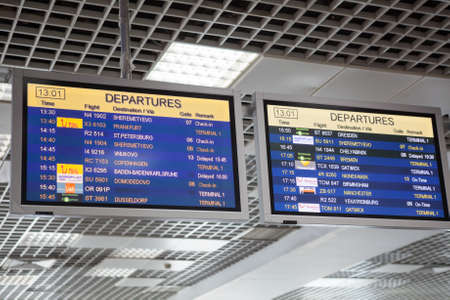 charter: HURGHADA, EGYPT - CIRCA NOV, 2015: Departures of charter flights are on the timetable at the airport. Destinations to the Russia Federation
