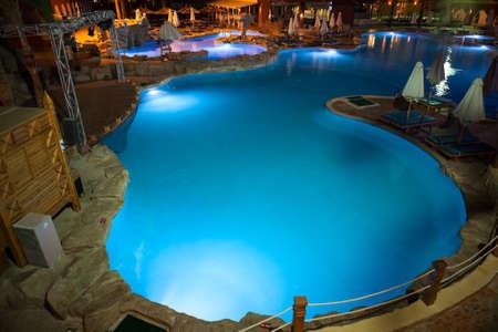 illuminated: HURGHADA, EGYPT - CIRCA NOV, 2015: Night illuminated swimming pool and poolside are in the Egyptian hotel. The Alf Leila Wa Leila spa 1001 Nights is one of the Pickalbatros