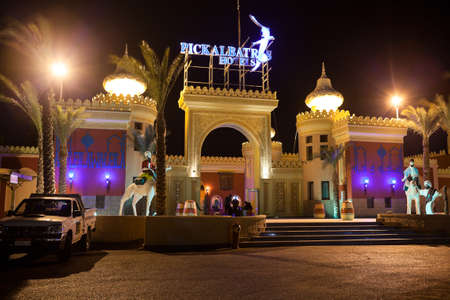 alf: HURGHADA, EGYPT - CIRCA NOV, 2015: View at the night illumination of droppoff zone and main entrance of the Egyptian hotel. The Alf Leila Wa Leila spa 1001 Nights is one of the Pickalbatros