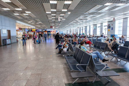gatehouse: HURGHADA AIRPORT, EGYPT - CIRCA NOV, 2015: Waiting room and gatehouse are in Hurgada International Airport. People are waiting departures from Egypt to Russia