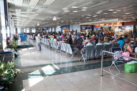 gatehouse: HURGHADA AIRPORT, EGYPT - CIRCA NOV, 2015: Waiting lounge and gatehouse are in Hurgada International Airport. Crowd of people are waiting departures from Egypt to Russia