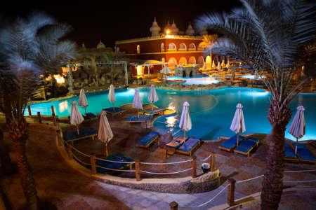 alf: HURGHADA, EGYPT - CIRCA NOV, 2015: Egyptian hotel poolside with beautiful night illumination. The Alf Leila Wa Leila spa 1001 Nights is one of the Pickalbatros