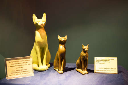 cultural artifacts: HURGHADA, EGYPT - CIRCA NOV, 2015: Three bronze statues of the cat goddess Bastet is in the hotel museum. The Alf Leila Wa Leila spa 1001 Nights are one of the Pickalbatros chain in Hurgada Editorial