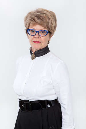 wrinkled: Portrait of calm senior woman in eyeglasses, looking at camera Stock Photo