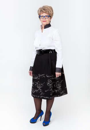 wrinkled: Full length portrait of elderly Caucasian woman standing on gray background