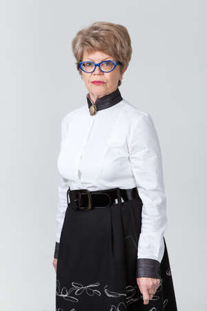 wrinkled: Portrait of attractive mature woman in eyeglasses, looking at camera