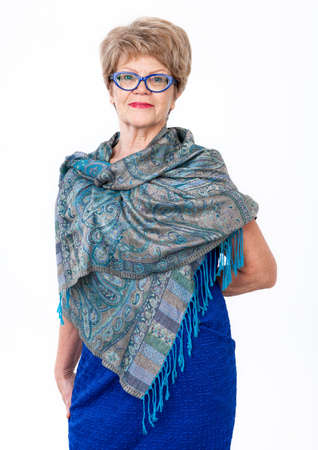 wrinkled: Elderly woman portrait, standing wrapped in shawl, white background Stock Photo