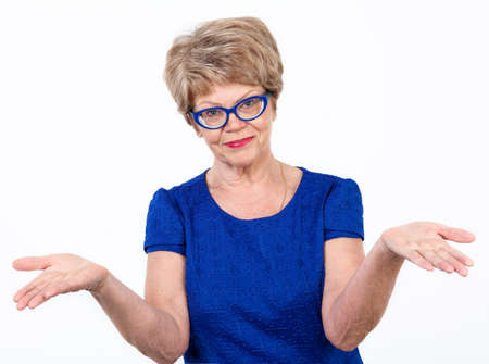 Pretty mature European woman making a helpless gesture, white background