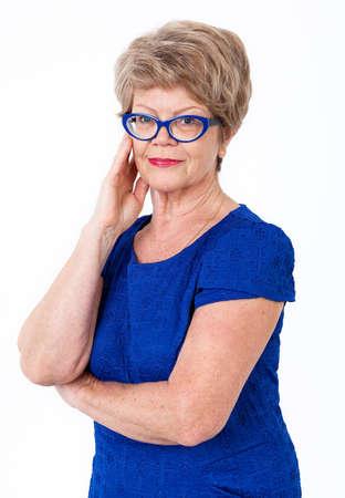 aging: Smiling senior woman portrait, blue dress, eyeglasses, white background